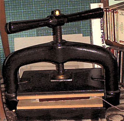 The leather is left to dry in the nipping press