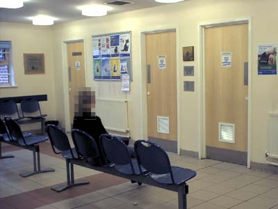 Reception area showing the doors to the consulting rooms.