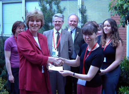 Ann presents a cheque to Marilyn Rydström, PDSA's Director General